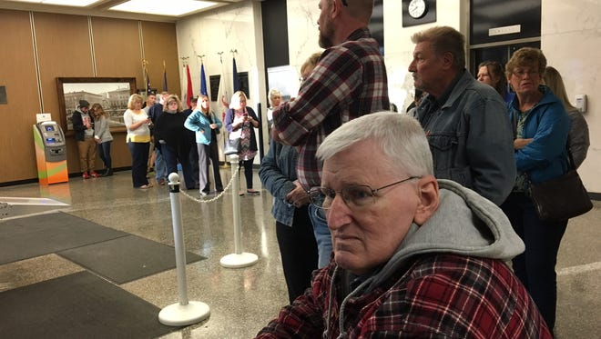 Allan Rowlett was the first in line to vote in the Delaware County Building on Monday, the last day of early voting.