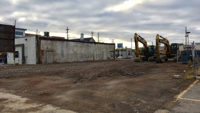 The site where the former Puritan Uniform building used to stand at 206-208 W. Breckinridge St. south of Broadway had been cleared by Wednesday morning.