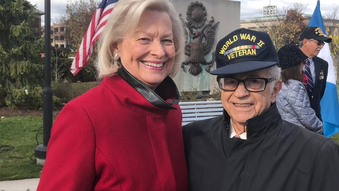 Barb Suhay with World War II veteran Paul Cicchini of Birmingham.