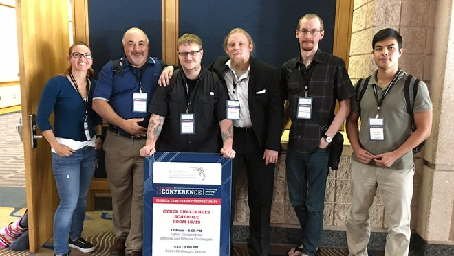 UWF Cyber Club poses for a picture after winning the Cyber Defense Challenge at the Florida Center for Cybersecurity's third annual conference in Tampa.