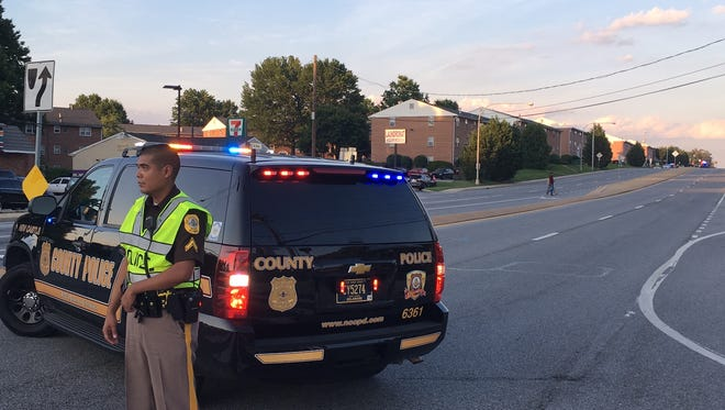 New Castle County Police block off Christiana Road near Georgetown Manor Apartments. On Tuesday, New Castle County Council approved taking the county's police force to 420 officers.