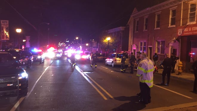 Emergency responders in the 900 block of Maryland Ave. for an apparent shooting on Friday, Nov. 18.