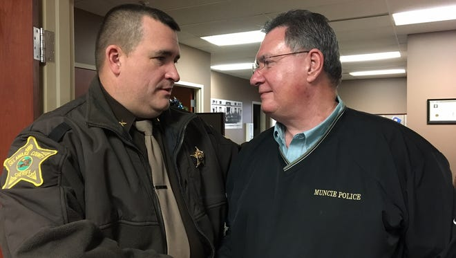 Sheriff Ray Dudley and Muncie Police Sgt. Paul Singleton Wednesday afternoon, as Dudley congratulates Singleton on his naming as the new city-county 911 director.