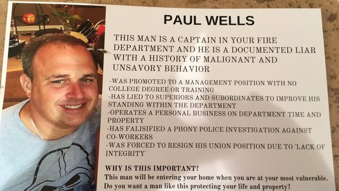 This flier about Birmingham Fire Captain Paul Wells was mailed to 1,000 homes. Wells said the photograph was lifted from his wife's Facebook page, and that his two young children were cropped out of it.
