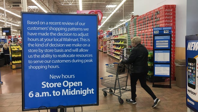 The sign inside the southside Muncie Wal-Mart announcing the end of overnight hours.