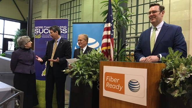 Jud Fisher (at lectern) opens a Tuesday announcement of the fiber optic-ready status of four area industrial parks. Delaware County Commissioner Sherry Riggin, AT&T Indiana director of external affairs Jim Tackett and Mayor Dennis Tyler were also on hand.
