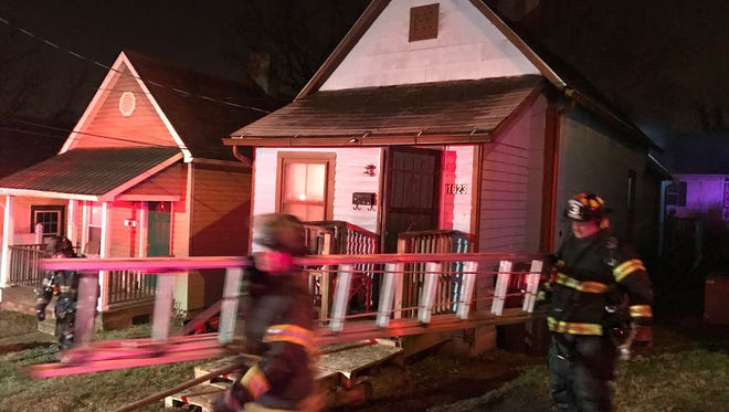 Knoxville Fire Department units at the scene of a house fire on Harvey Street in North Knoxville on Monday, Feb. 6, 2017.