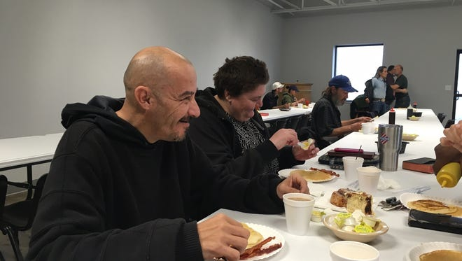 Last Sunday, a couple sat down to a meal of pancakes and bacon at Breakfast at the Heights. Food is served until everyone is full and then leftovers are sent home. A majority of the people in the neighborhood come not just for the free pancakes, but also to visit with friends, share stories and worship.