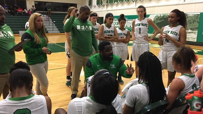 Fort Myers High girls basketball coach Chad Terrell talks to his team during its 65-36 win over Golden Gate in 7A regional quarterfinal action