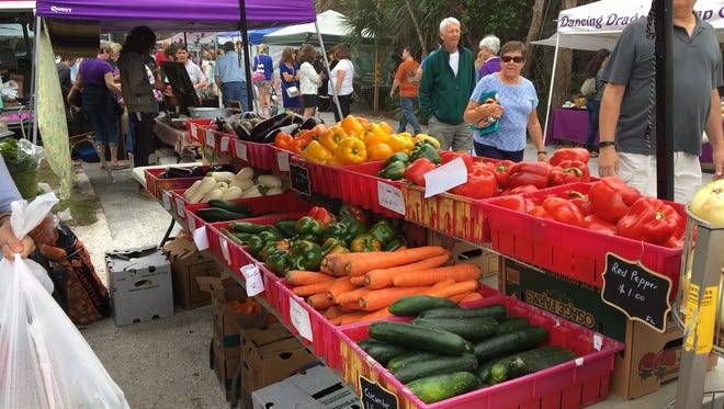 Sanibel Farmers Market drew heavy crowds on a Superbowl Sunday.  Farmers markets are still allowed during the coronavirus crisis, but the city council ordered that only food can be sold.