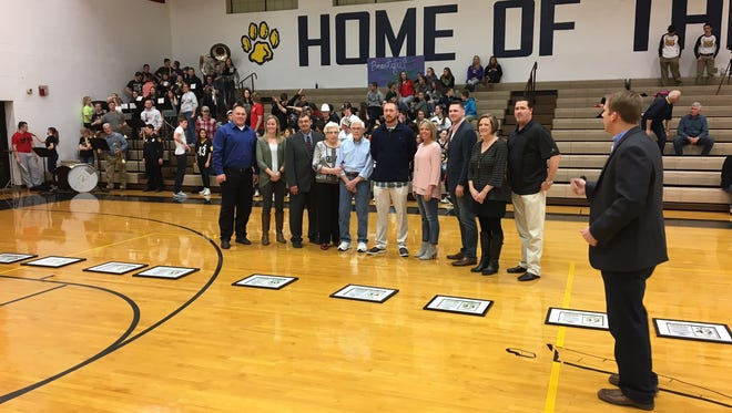 Michael Perkins, Megan Abbey, Tom Rymers, Alicia Gerwin's grandparents, Lillian and Roger Gerwin, Andy Rippke, Amy Perkins, Tyler Rosenberger, Lori Kuhlman and Jeff Haar were recognized Friday at Woodmore. They are the members of the Wildcats' 1,000-point club.
