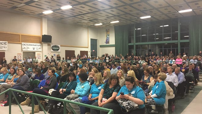 A packed audience at DeMasi Middle School listens at a past Evesham Township Board of Education Meeting Thursday night, but in-person attendance at school board meetings there is now extremely limited because of concerns about the ongoing coronaviruis pandemic threat to public health.