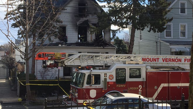 The house in Mount Vernon that caught fire early Sunday and left two people dead.