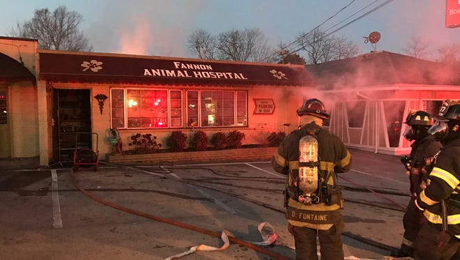 Firefighters from the Knoxville Fire Department battle a 6 a.m. fire at the Fannon Animal Hospital on Clinton Highway on Saturday, March 4.