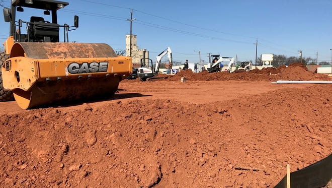 A crew continues dirt work during the early stages of the construction of a Family Dollar at the corner of Martin Luther King Jr. Boulevard and Seventh Street. It's the first commercial project on the city's east side in quite some time.