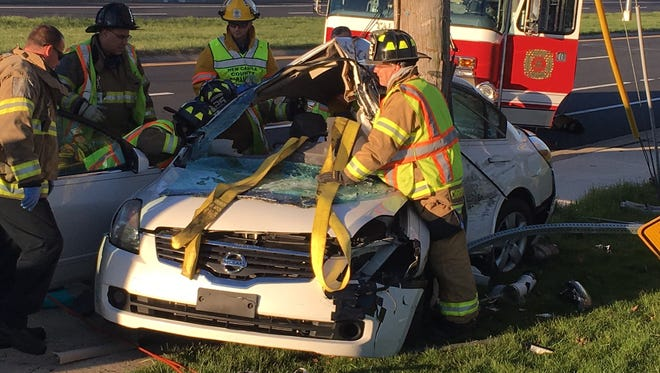 The driver was trapped in her car for about 30 minutes until firefighters could free her.