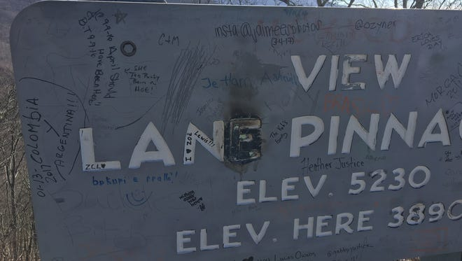 Graffiti on the Blue Ridge Parkway, such as this overlook sign north of Asheville, has been increasing.