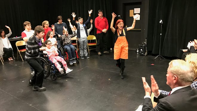 Rep. Leonard Lance, right foreground, applauds teaching artist Leslie Fannelli and students in the Paper Mill Playhouse 'Theater for Everyone' class on April 17.