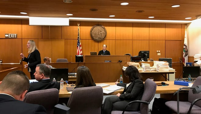 Defense attorney Lanetta Rinehart speaks to jurors in a trial over pesticides.