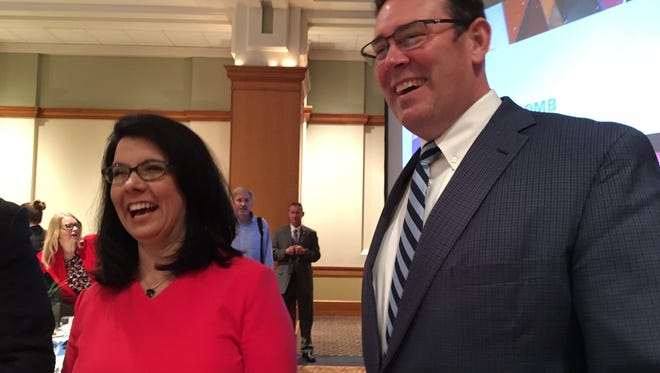 Indiana First Lady Janet Holcomb and her brother-in-law, Jud Fisher of Ball Brothers Foundation and Delaware Advancement Corporation, laugh after Holcomb's Tuesday morning speech in Muncie.