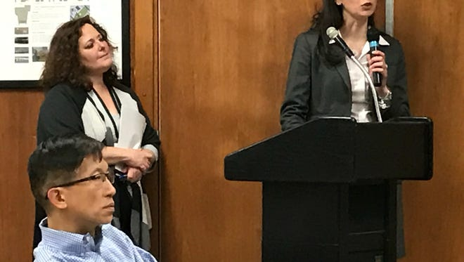 Christine Burton, superintendent of the Millburn School District, introduces Business Administrator Cheryl Schneider to present the 2017-18 school budget at the April 24 Board of Education meeting. Seated is board Vice President Jesse Liu, who chairs the board's Finance Committee.