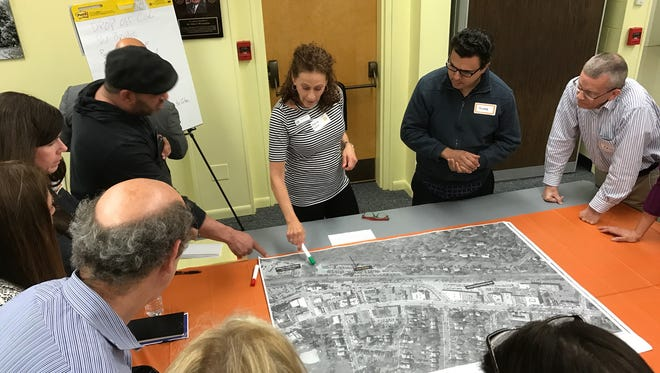 Diane Eglow leads a discussion group at the Complete Streets public forum May 3.
