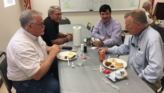 County Commissioner Van Smith, Sheriff Joe Sedinger and county attorneys Kyle Shirley and Robert Faulk enjoy lunch Tuesday at the sheriff's office.