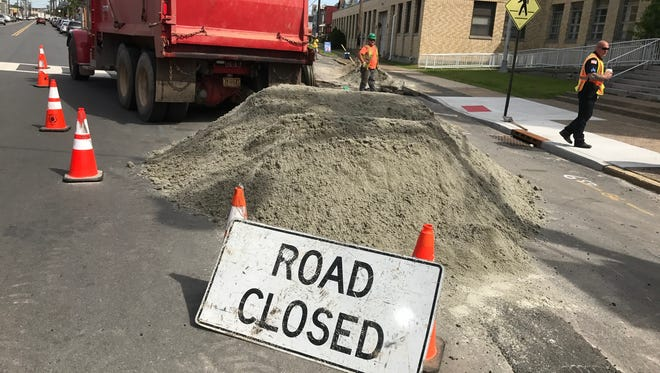 PSE&G crews have been digging up streets near the farmers market in Paterson to install a new gas line.