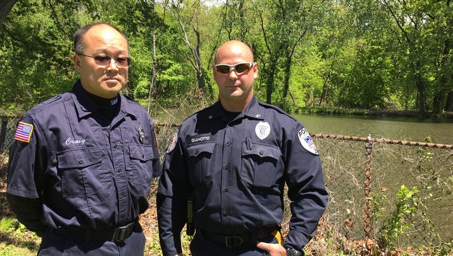 South Bound Brook Firefighter Craig Konkle and Bound Brook Police Officer Jason Gianotto are being honored by the 200 Club of Somerset County for a water rescue from the Delaware & Raritan Canal behind them.
