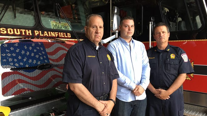 South Plainfield Fire Marshal Joseph Abbruzzese, New Jersey Corrections Office Bryan Bostick and South Plainfield Firefighter Michael Pellegrino are receiving valor awards from the 200 Club of Middlesex County for rescuing a woman from a house fire. Missing from the photo is Plainfield Fire Lt. John Reed, who is being honored with them.