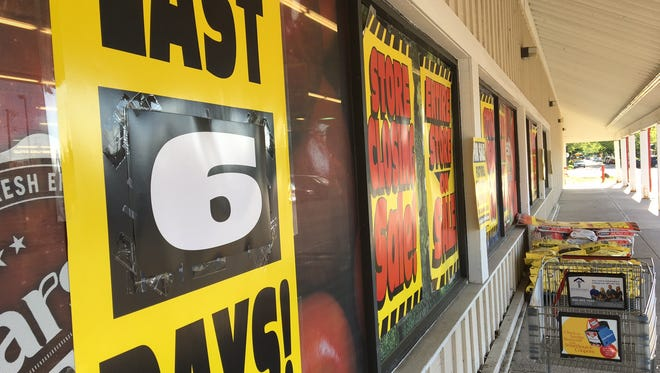 """Store closing"" and ""Last 6 Days!"" signs cover the windows at the Marsh supermarket on Hoyt Avenue in Muncie."