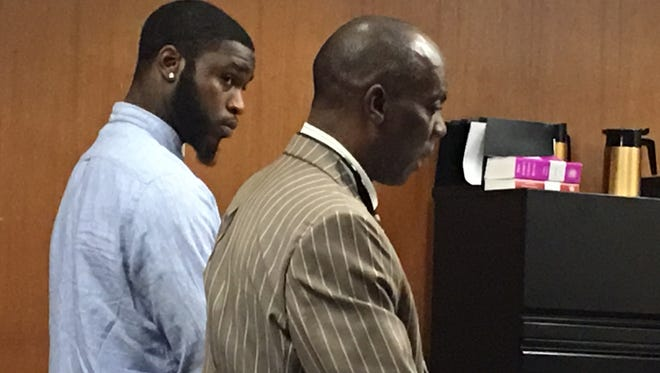 Former Rutgers football player Nadir Barnwell (left) of Piscataway with his attorney, Hassen Ibn Abdellah, in court Friday in New Brunswick.