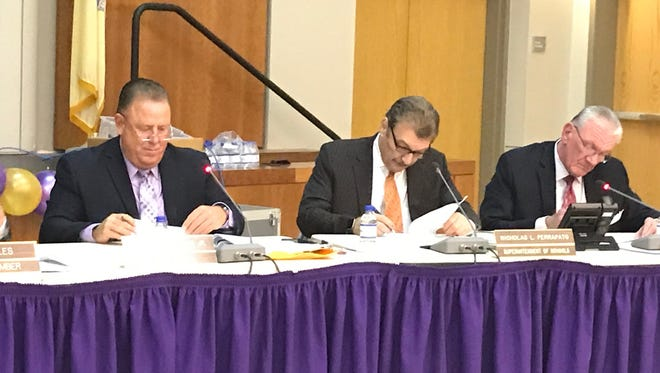 From left, Garfield Board of Education Vice President Everett Garnto, Schools Superintendent Nicholas Perrapato and Assistant Superintendent of Finance and Board Secretary Edward Izbicki at a school board meeting in May 2017.