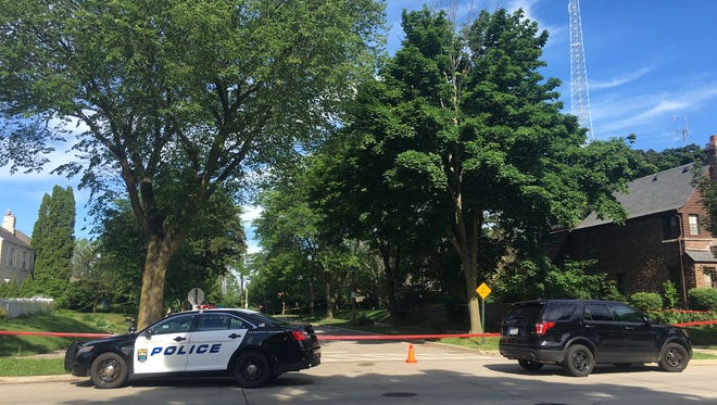 Shorewood police officers investigate an incident near Pinedale Court, just off Capitol Drive and not far from the village's border with Milwaukee, on June 21, 2017.