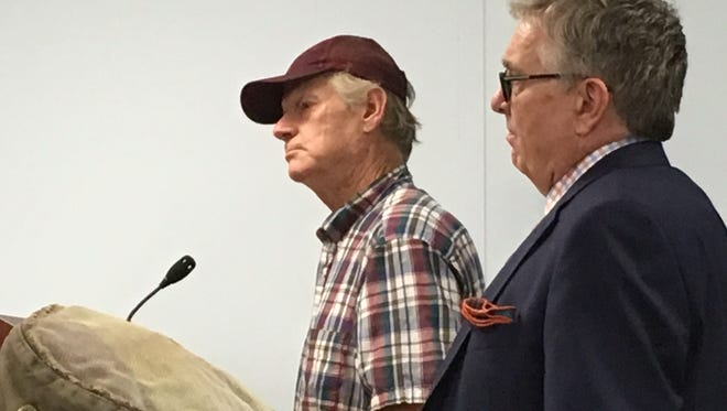 Mike McKeel, left, and attorney Bruce Munson at a plan commission meeting on Corvair collection.