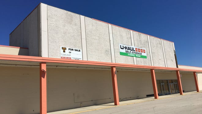 The former Kmart on Muncie's northeast side now has banners for U-Haul self-storage.