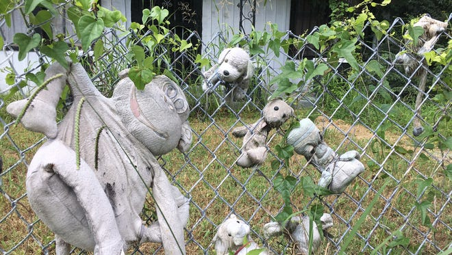 Faded stuffed animals hang on a fence near the intersection of Farrington Street and Hollowell in South Memphis on July 18, 2017, not far from where Robert Pollard Jr. and his mother were shot.