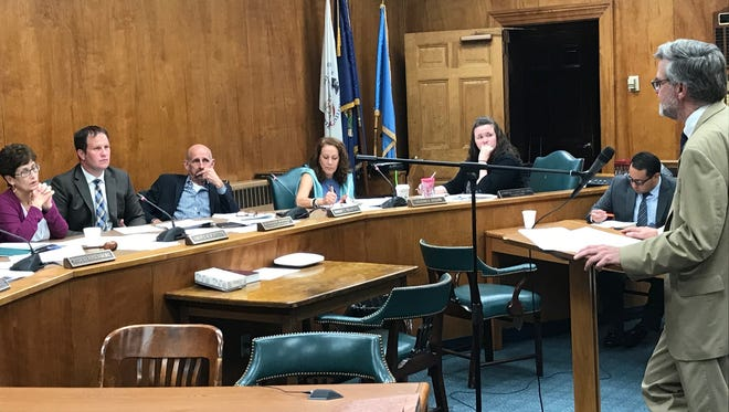 Planner Paul Phillips reports on new residential construction issues in the neighborhood around Washington School at the July 18 Township Committee meeting.