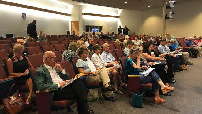 A crowd listens at the Santa Rosa County Commissioners meeting on Monday, July 24, 2017, in Milton.