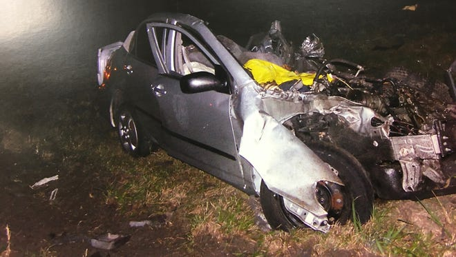 A crash scene photograph of the Toyota in which two Southwest Florida women, Kathleen O'Callaghan and Jennifer Jenkins, died in Hardee County, Fla., in 2011 on their way to Orlando was shown during the manslaughter trial of Michael J. Phillips on Wednesday, Aug. 23, 2017, in Wauchula, Fla.