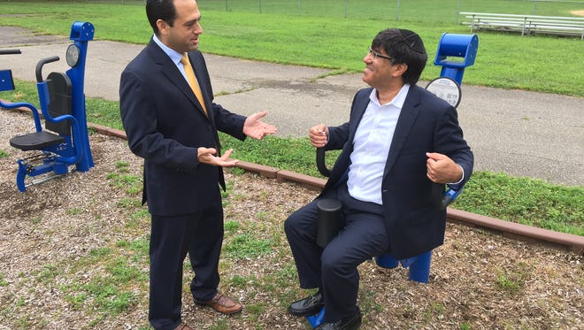 Englewood Councilman Michael Cohen and David Siegel of Xrcise Gym in Teaneck try out some of the outdoor exercise equipment at Phelps Park in Teaneck. Siegel donated similar equipment to Englewood to be installed at Tryon Park.