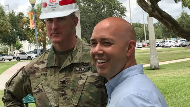 Col. Jason A. Kirk, head of the Army Corps of Engineers in Florida, right, and U.S. Rep. Brian Mast answer questions on Aug. 25, 2017, during a news conference outside Port St. Lucie City Hall.