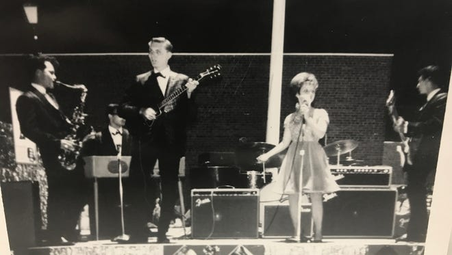 Singer Brenda Lee is backed up by Rocky & The Continentals.