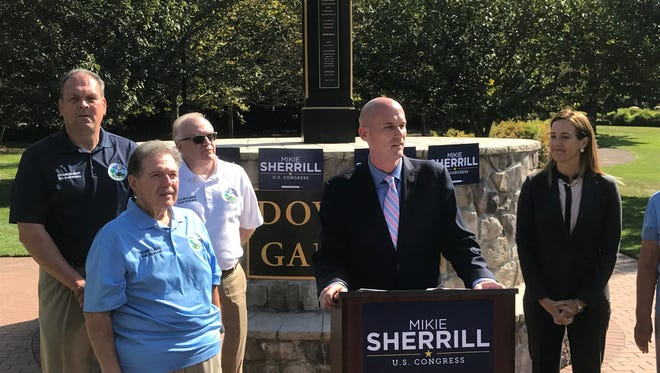 Woodland Park Mayor Keith Kazmark, ( C ), announces his endorsement of Mikie Sherrill for Congress in the 11th District. Kazmark is flanked by members of the Woodland Park council.