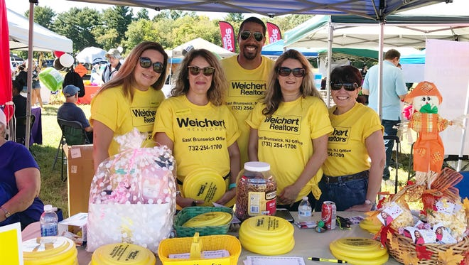 Josephine Edwards, manager and 13 of her sales associates from the Weichert, Realtors office in East Brunswick participated in the East Brunswick Day celebration, Sept. 23.