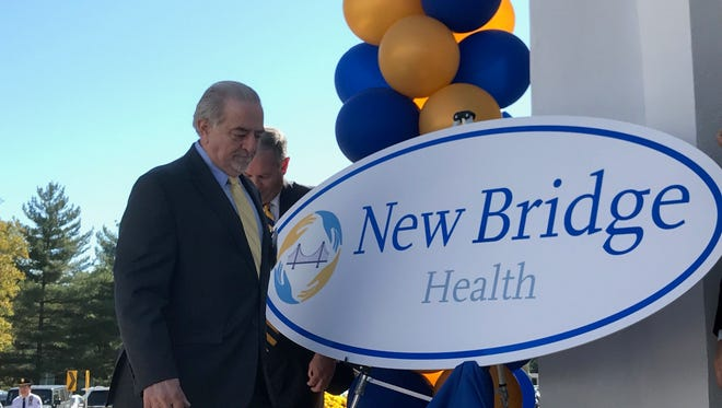 Joseph A. Masciandaro, chairman of Care Plus Bergen, and Bergen County Executive unveil the sign for New Bridge Medical Center at a ceremony on Oct. 2.