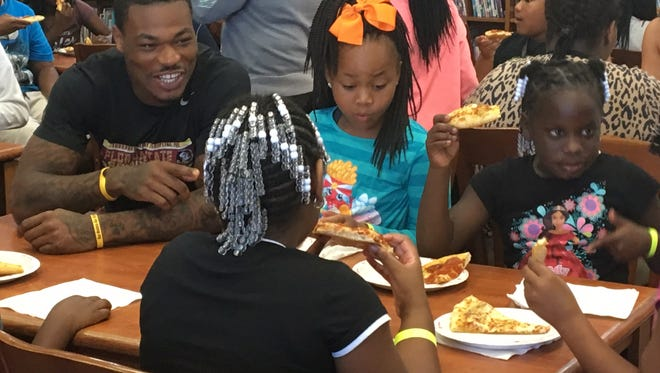 Florida State safety Derwin James sits at a table with Riley Elementary School students on Wednesday.