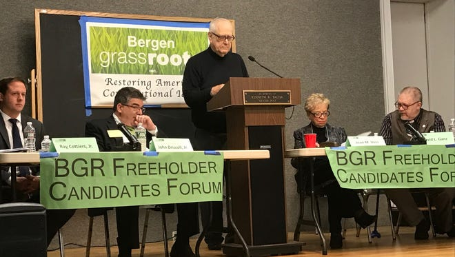 Republican challengers Ray Cottiers and John Driscoll, at left, facing Democratic incumbents Joan Voss and David Ganz at the Teaneck Library on Tuesday night. At the podium is moderator Charles Powers.