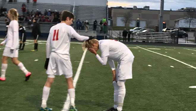 Wausau East's Ryan Keefs (11) tries to console Max Sorenson after a 3-0 loss to New Richmond in a Division 2 sectional championship match Saturday at Jay Stadium in Merrill.