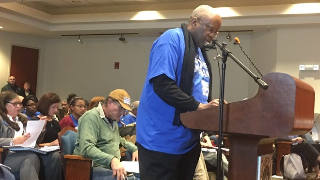 Pastor Edward Long speaks in opposition to a proposed Indiana Michigan Power rate increase at a hearing Monday night in City Hall.